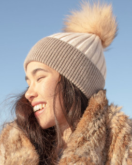 Kinley Knit Beanie Hat with Finn Raccoon Pom Pom in Cream/Brown